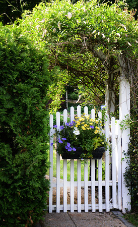 JIM VAIKNORAS/Staff photo  One of the gates in the garden of Joe and Carol Flynn at 412 Main Street in Amesbury.