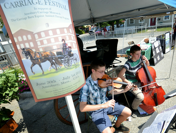 JIM VAIKNORAS/Staff photo The Weirtz twins, Connor on Violin and Aidan on Cello, making up the Double Stop Strings, perform at the Amesbury Days Farmer Market at City Hall Saturday.