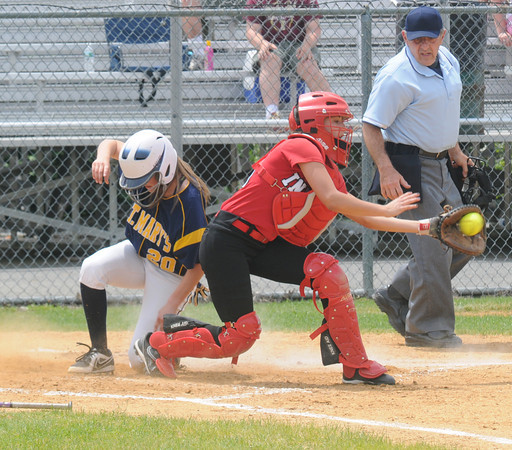 JIM VAIKNORAS/Staff photo Amesbury's Amanda Schell fields late throw as St Mary's Vanessa Van Bustirk during the North Final at Martin Field in Lowell Sunday. The Indians lost the game 8-4.