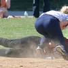 JIM VAIKNORAS/Staff photo Amesbury's megan Aponas slides into 3rd just the tag of Notre Dame's Deanna Desmond during their game at Amesbury Middle School Tuesday.
