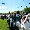 JIM VAIKNORAS/staff photo Graduate s toss their caps after getting their diplomas at Pentucket's Commencement Saturday at the high school in West Newbury.