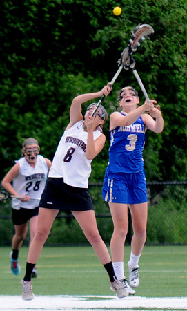 JIM VAIKNORAS/Staff photo Newburyport's Julia Kipp fights for the ball with Norwell's CarolineWalsh at Babson College in Wellesley Monday night. The Clippers won the game and will play for the state title Saturday at BU.