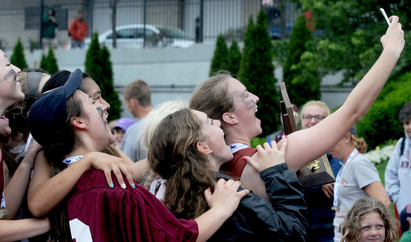 JIM VAIKNORAS/Staff photo Newburyport 's Lilly Donovan takes a seflie of her and her teammates Saturday's after they won the state championship 7-7 over Bromfield at Boston University.