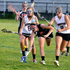 JIM VAIKNORAS/Staff photo Newburyport's Grace Johnson and Julia Kipp fight for the ball with Marblehead's Lucie Poulin during their game at War Memorial Stadiu in Newburyport Saturday night.