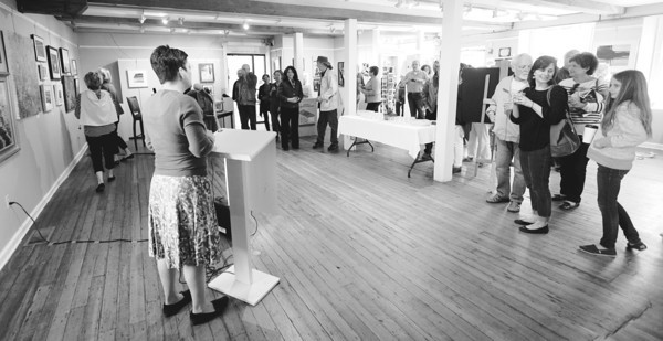 JIM VAIKNORAS/Staff photo Director Elena Bachrach speaks at the Newburyport Art Association Saturday as part of the Cultural District celebration held through out Newburyport.
