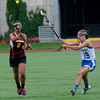 JIM VAIKNORAS/Staff photo Newburyport 's Brenna Williams passes the ball while being guarded by Bromfield's Meaghan Parlee Saturday.The Clippers won the state championship 7-6 over Bromfield at Boston University.