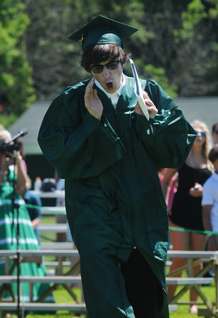 JIM VAIKNORAS/staff photo Graduate cameron Silveira howls after getting his diploma at Pentucket's Commencement Saturday at the high school in West Newbury.