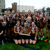 JIM VAIKNORAS/Staff photo Newburyport girls lacrosse team pose with their state championship trophy as a light rain begins to fall. The Clipper defeated Bromfield 7-6 to win the title at Boston University Saturday.