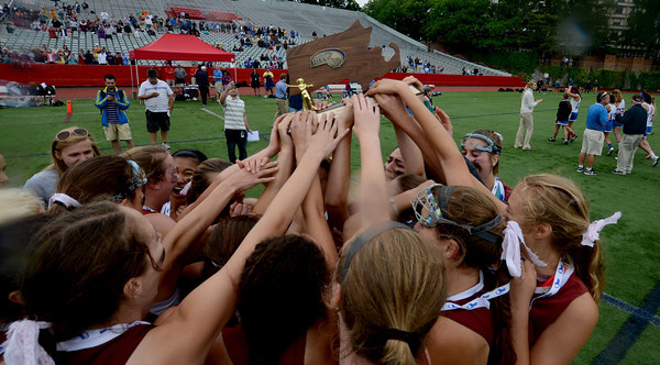 JIM VAIKNORAS/Staff photo Newburyport girls lacrosse team celebrates their state championship. The Clipper defeated Bromfield 7-6 to win the title at Boston University Saturday.