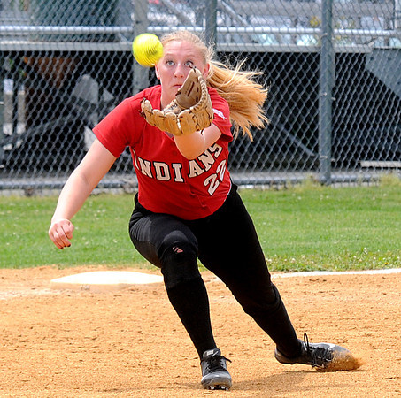 JIM VAIKNORAS/Staff photo Amesbury's Autumn Klingerman makes a diving catch on an infield popup against St Mary's during the North Final at Martin Field in Lowell Sunday. The Indians lost the game 8-4.
