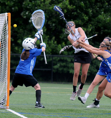 JIM VAIKNORAS/Staff photo Newburyport's Julia Kipp scores on Norwell's Caroline Nichols at Babson College in Wellesley Monday night. The Clippers won the game and will play for the state title Saturday at BU.