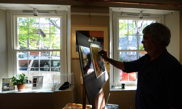 JIM VAIKNORAS/Staff photo Artist Tom Baily works on a piece at the Newburyport Art Association Saturday as part of the Cultural District celebration held through out Newburyport.