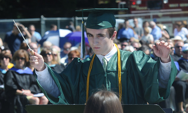"JIM VAIKNORAS/staff photo Graduate Ryan Dymek conducts the band in  ""In The Shining of the Stars"" at Pentucket's Commencement Saturday at the high school in West Newbury."
