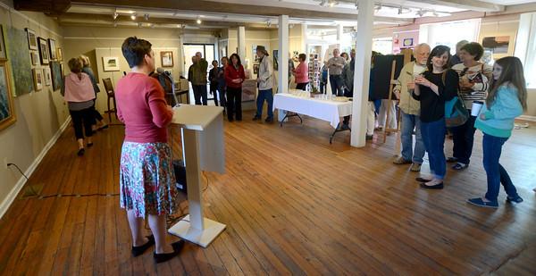 JIM VAIKNORAS/Staff photo Director Elena Bachrach speaks at the Newburyport Art Association Saturday as part of the Cultural District celebration held through out Newburyport.