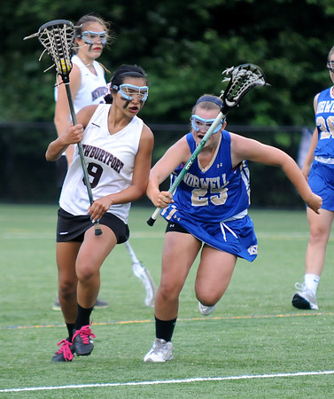 JIM VAIKNORAS/Staff photo Newburyport's  Brenna Williams out races  Norwell's Lauren Arapoff  at Babson College in Wellesley Monday night. The Clippers won the game and will play for the state title Saturday at BU.