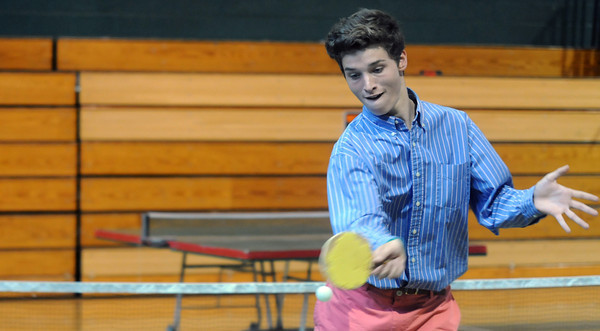 JIM VAIKNORAS/Staff photo  Pentucket high tennis player Jack Donahue returns the ball while playing ping-pong with teammate Connor Aulson on the last day of school.