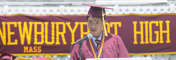 JIM VAIKNORAS/Staff photo Newburyport high Salutatorian Shudee Wu speaks at graduation Sunday at War Memorial Stadium.