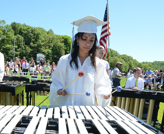 "JIM VAIKNORAS/staff photo Graduate Emily Daroga performs with the Chorus and Percussion Ensemble in a redition of ""Send Me on My Way"" at Pentucket's Commencement Saturday at the high school in West Newbury."