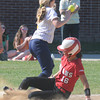 JIM VAIKNORAS/Staff photo Amesbury's Amanda Schell slides into 3rd just before the throw to Notre Dame's Deanna Desmond during their game at Amesbury Middle School Tuesday.