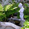 JIM VAIKNORAS/Staff photo  A small fountain in the garden of Joe and Carol Flynn at 412 Main Street in Amesbury.