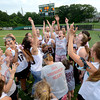 JIM VAIKNORAS/Staff photo Newburyport's Girls Lacrosse Team celebrates their victory over Norwell at Babson College in Wellesley Monday night. The win gives the girls shot at the state title Saturday at BU.
