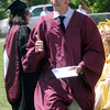 JIM VAIKNORAS/Staff photo Newburyport high graduate Jonathan Gray Jr make the hang loose sign after getting his diploma Sunday at War Memorial Stadium.