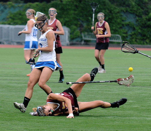 JIM VAIKNORAS/Staff photo Newburyport 's Olivia Kearney collides with Bromfield'sJaqueline Planchet during Saturday's state championship game at Boston University.kearney injured her hip on the play but returned to play later in the game. The Clippers won the game and the chamionship 7-6.