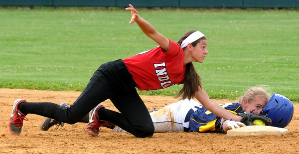 JIM VAIKNORAS/Staff photo Amesbury's Madison Napoli tags out St Mary's Molly Mello during the North Final at Martin Field in Lowell Sunday. The Indians lost the game 8-4.