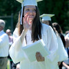 JIM VAIKNORAS/staff photo Graduate Adrianna Early waves after getting her diploma at Pentucket's Commencement Saturday at the high school in West Newbury.