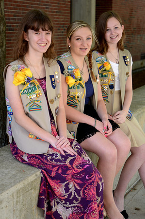 JIM VAIKNORAS/Staff photo  Girl Scout Gold Award winners Jolene Buczala, Amanda Rotberg, and Madeleine Scmuch at Triton high in Byfield.