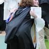 JIM VAIKNORAS/Staff photo jaclyn Sarette hugs coach Ruth Beaton after getting her diploma at Pentucket graduation Saturday.