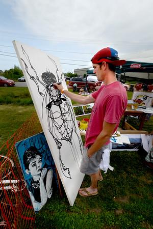 JIM VAIKNORAS/Staff photo <br /> Artist Shane Taylor draws a Greenhead Fly Saturday at Folk & Bluegrass  GET DOWN at Newburyport Brewery Co..