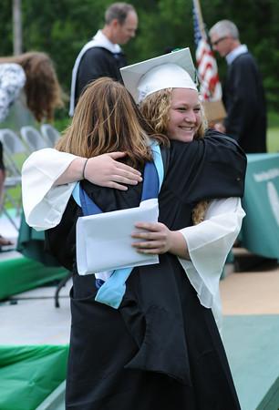 JIM VAIKNORAS/Staff photo Hannah Zaneski hugs teacher Diane Kelly after getting her diploma at Pentucket graduation Saturday