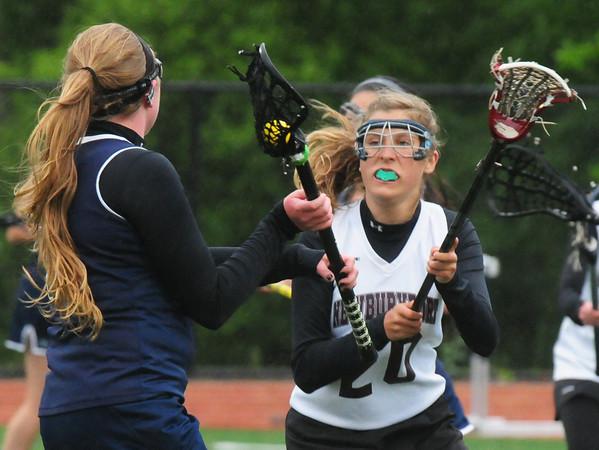 BRYAN EATON/Staff Photo. Newburyport's Olivia Kearney defends against an Essex Tech player.