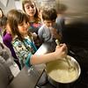 BRYAN EATON/Staff Photo. Leah Habib, 8, stirs the cheese sauce.