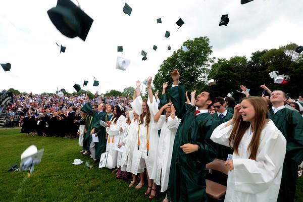 JIM VAIKNORAS/Staff photo Graduates toss their caps at Pentucket graduation Saturday.