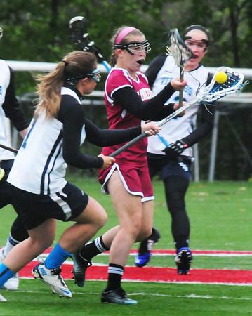 BRYAN EATON/Staff Photo. Triton's Samantha Thibault moves down field as Gloucester's Rachel Alexander tries to get the ball.
