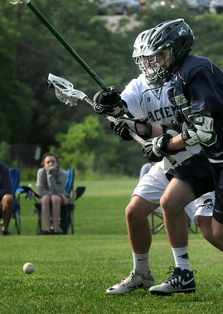BRYAN EATON/Staff Photo. Pentucket's Andrew Gould and Essex Tech's 15 scramble for the ball.