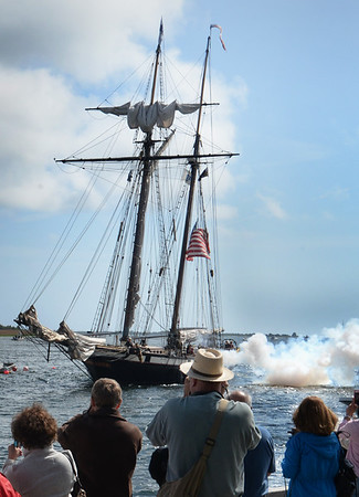 BRYAN EATON/Staff Photo. The privateer Lynx fires a gun as it approaches Newburyport's waterfront yesterday.