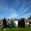 JIM VAIKNORAS/Staff photo Seniors march in under blue skies at Pentucket high graduation Saturday.