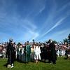 JIM VAIKNORAS/Staff photo Seniors march in under blue skies at Pentucket high graduation Saturday.