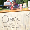 JIM VAIKNORAS/Staff photo 6/25/2016  Wyatt Allard, 13, sells organic ice coffee in front of his High Street home in Newburyport Saturday. Wyatt had sold lemonaide in the past but was dispointed in his profit margin, so he switched to coffee.