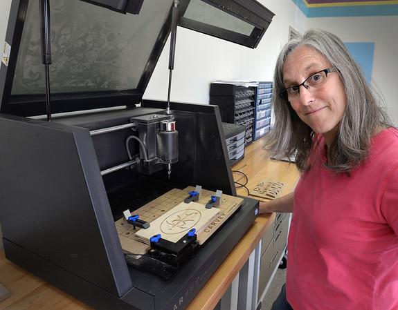 BRYAN EATON/Staff photo. Sparhawk School teacher Jen Esty with the schools new Carvey computer numeric control.