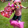 BRYAN EATON/Staff Photo. With her tutu falling off, Tara Sullivan, 10, competes in the Pretty In Pink relay during Survivor Day which her teacher Anne Enaire organized at the Molin Upper Elementary School in Newburyport. Much like field days at area schools, the day is filled with different stations in which the students compete in the spirit of teamwork and fun.