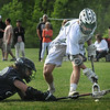BRYAN EATON/Staff Photo. Pentucket's Liam Sheehy scoops the ball from a downed Essex Tech player.