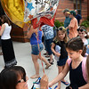 BRYAN EATON/Staff photo. Valerie Natoli gives her daughter Juliette Paquette a birthday balloon as she gets out of school for the year. The Bresnahan School student turned seven yesterday, an extra birthday gift being the last day of school.