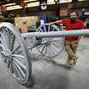BRYAN EATON/Staff Photo. Trevor Bartley who spent time sandblasting and painting this cannon made in New York in 1892 which had been at the Prospect Cemetery in Amesbury where it will be returned.