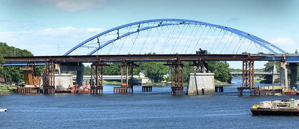 BRYAN EATON/Staff Photo. The last of the arches of the Whittier Bridge have been removed as pretty much all that remains are the granite piers. Construction is moving along on the new bridge, one of the forms for the concrete piers is taking shape at far left.