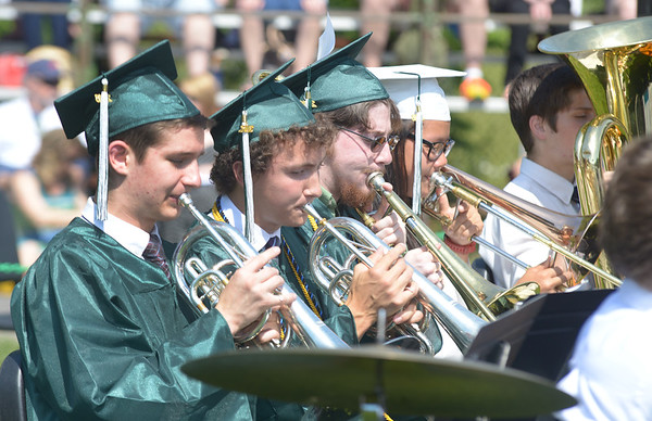 JIM VAIKNORAS/Staff photo Seniors James Wengler and Ian Sands on mellophone and Nicola Elardo and Brenda Schwartz on trombone play with the band for the last time at the Pentucket high graduation Saturday.