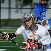 BRYAN EATON/Staff Photo. Newburyport's 26 makes a quick turn to evade a Stoneham player.